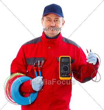 Handsome Confident Electrician With Electrical Equipment Stock Photo