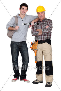 Handyman And His Trainee. Stock Photo