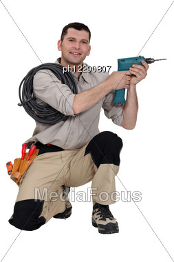 Handyman Holding A Power Tool Stock Photo