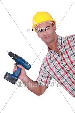 Handyman Showing-off His New Cordless Drill Stock Photo