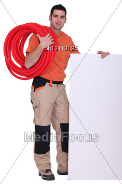 Handyman With Cabling Around His Shoulder Stock Photo