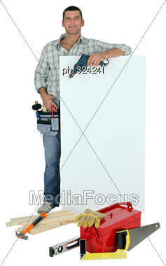Handyman With Tools And Message Board Stock Photo