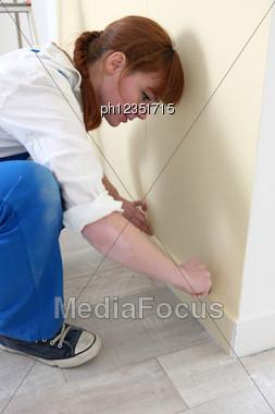 Handywoman Taking Measures Stock Photo