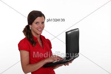 Happy Brunette Holding Laptop Stock Photo