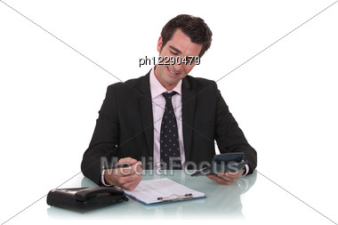 Happy Businessman With A Calculator Stock Photo