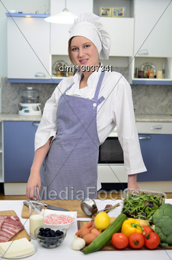 Happy Cook In The Kitchen Stock Photo