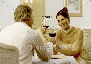 Happy Couple Celebrating Stock Photo
