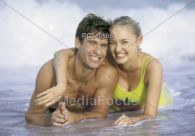 Happy Couple Enjoying the Beach Stock Photo