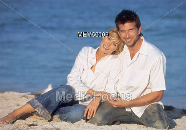 Happy Couple on the Beach Stock Photo