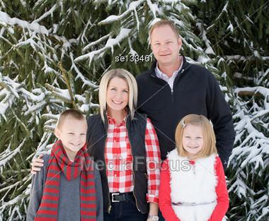 Happy Family at Christmas Stock Photo