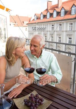 Happy Mature Couple Having Drinks Stock Photo