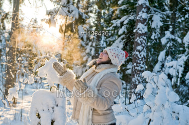 Happy Middle-aged Woman Having Fun On Winters Day In Forest Stock Photo