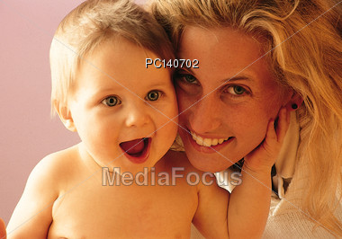 Happy Mother and Baby Stock Photo