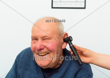 Happy Patient At The Otolaryngology, Making Fun With Doctor During Examination With Auroscope Stock Photo