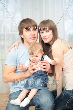 Happy Young Family Of Three Person Stock Photo