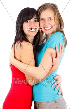 Happy Young Friends Hugging Each Other And Smiling Stock Photo