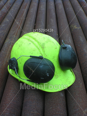 Hard Hat On Pipes For Drill String At Oil Well, West Coast, South Island, New Zealand Stock Photo