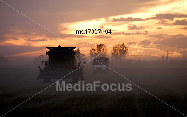 Harvest Sunset Saskatchewan Colorful Combines And Buildings Stock Photo