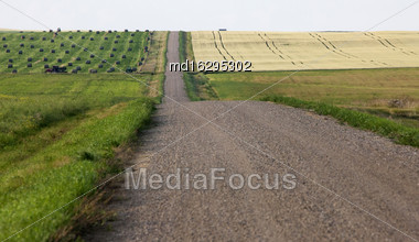 Hay Bales Saskatchewan And Country Road Gravel Stock Photo