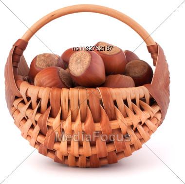 Hazelnuts In Wicker Basket Isolated On White Background Stock Photo