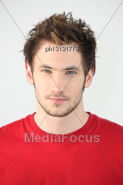 Head-and-shoulders Portrait Of Young Man With Neutral Expression Stock Photo