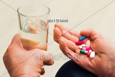 Health Issues At An Old Age, Taking Several Medicines Stock Photo