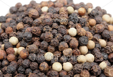 Heap Of Black And White Pepper. Close-up. Studio Photography Stock Photo