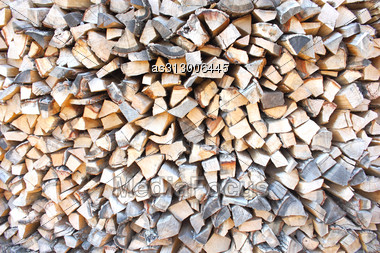 Heap Of Firewoods As Background . Close - Up . Stock Photo
