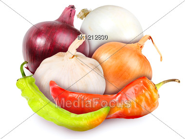 Heap Of Fresh Motley Onions, Garlic And Peppers. Placed On White Background. Close-up. Studio Photography. Stock Photo