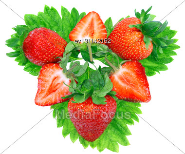 Heap Of Fresh Strawberries On Green Foliage . Isolated Stock Photo