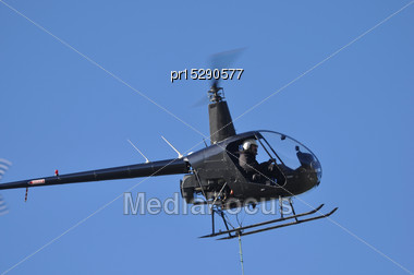 Helicopter Lifts A Load For A Job In Westland, New Zealand Stock Photo