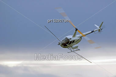 Helicopter Spraying Fertiliser On A Crop In Westland, New Zealand Stock Photo