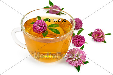 Herbal Teas With Clover In A Glass Bowl, Flowers Of Clover Stock Photo