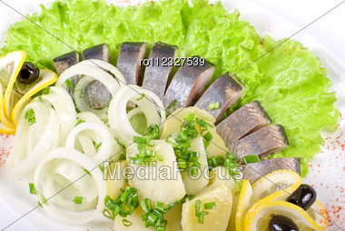 Herring With Potato And Fresh Vegetables Closeup Stock Photo