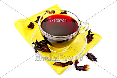 Hibiscus Tea In A Glass Cup, Dry Petals Tea On Yellow Napkin Stock Photo
