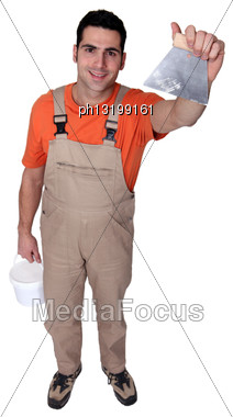 High Angle Shot Of Man With Plaster Knife Stock Photo