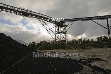 High Grade Coking Coal Piles Up At A Loading Facility For A Coal Mine Stock Photo