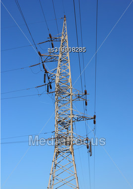 High Voltage Post Against The Blue Sky Stock Photo