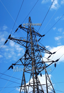 High Voltage Tower On Blue Sky Background Stock Photo
