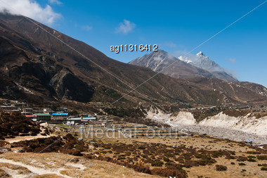 Himalayas In Nepal: Highland Village And Peaks. Large Resolution Stock Photo