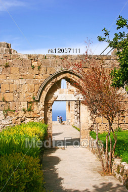Historic Bellapais Abbey In Kyrenia, Northern Cyprus.Original Construction Was Built Between 1198-1205, It Is The Most Beautiful Gothic Building In The Near East. Stock Photo