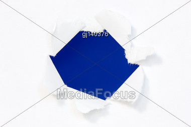 Hole In A Paper With Blue Background Inside Stock Photo