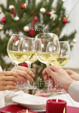 Holiday Toast with Wine Glasses Stock Photo