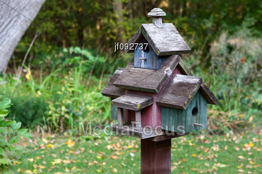 Home Made Wooden Bird House On A Pole Stock Photo