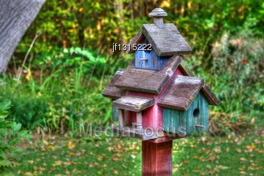 Home Made Wooden Bird House On A Pole In High Dynamic Range Stock Photo