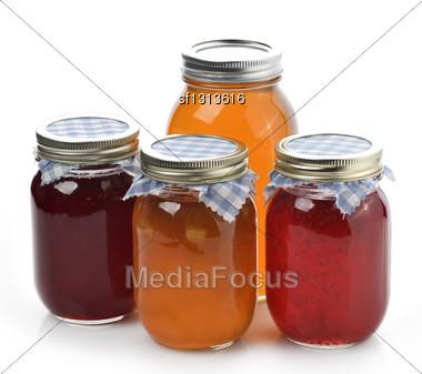 Homemade Marmalade,Jam And Honey In Glass Jars Stock Photo