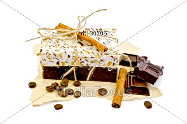 Homemade Soap Beige And Brown, Cinnamon, Chocolate Bars, Coffee Beans On A Piece Of Yellow Old Paper Stock Photo