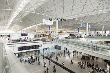 HONG KONG, CHINA - FEBRUARY 21: Passengers In The Airport Main Lobby On February 21, 2013 In Hong Kong, China. The Hong Kong Airport Handles More Than 70 Million Passengers Per Year Stock Photo