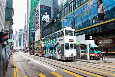 HONG KONG - FEBRUARY 21: Double Trams With Advertisements At Hennessy Rd. Road Show Provides Advertisements To The Passengers Of Public Vehicles On Febuary 21,2013 In Hong Kong Stock Photo
