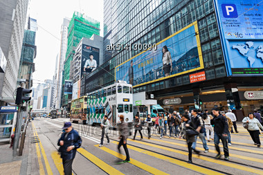 HONG KONG - FEBRUARY 21: Unidentified People Crossing The Street On February 21, 2013 In Hong Kong. With A 7 Million People, Hong Kong Is One Of The Most Densely Populated Areas In The World Stock Photo